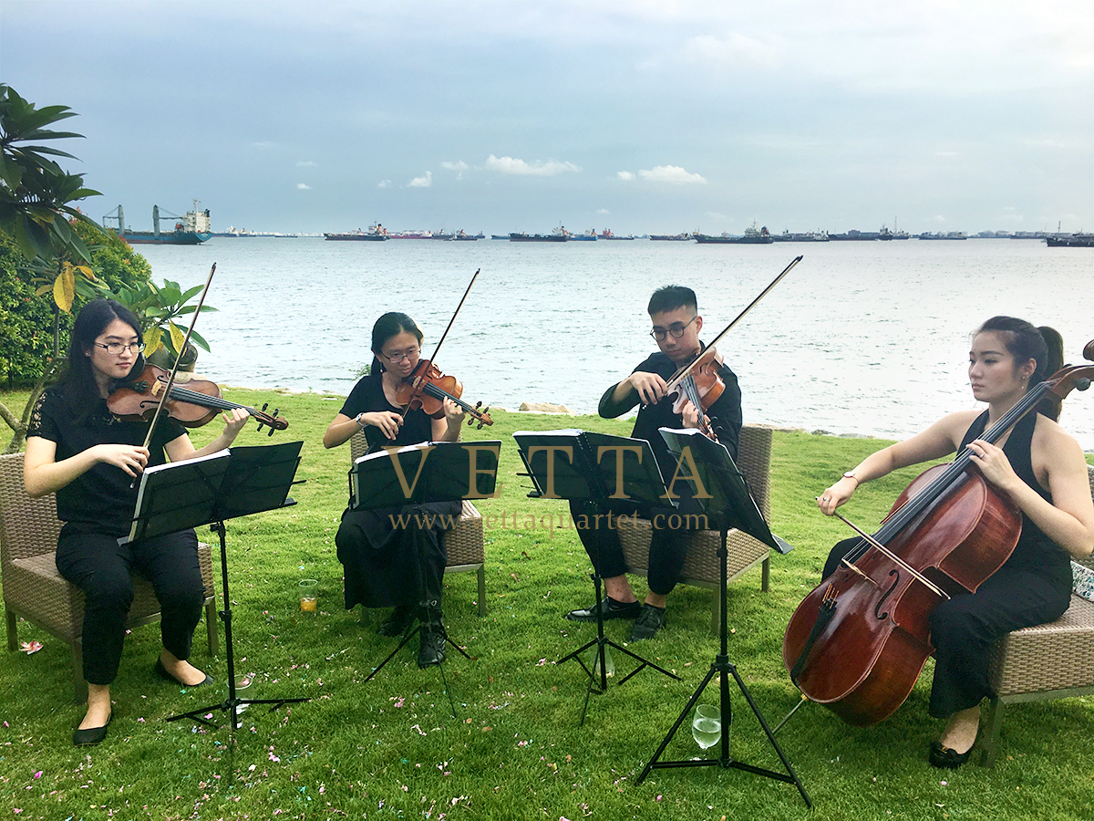 Live String Music playing for Grace and Zhao Hao's wedding at Barnacles by the sea