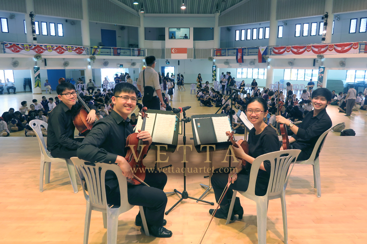 String Quartet playing for educational outreach to teach students singapore secondary school